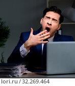 Купить «Businessman tired and sleeping in the office after overtime hour», фото № 32269464, снято 21 декабря 2017 г. (c) Elnur / Фотобанк Лори