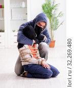 Купить «The armed man assaulting young woman at home», фото № 32269480, снято 15 декабря 2017 г. (c) Elnur / Фотобанк Лори