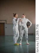 Купить «A portrait of two young women fencers laughing», фото № 32269716, снято 5 октября 2019 г. (c) Константин Шишкин / Фотобанк Лори