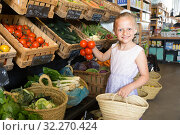 Купить «girl choosing vegetables in vegetable shop. on the signboard inscriptions in Catalan», фото № 32270424, снято 29 февраля 2020 г. (c) Татьяна Яцевич / Фотобанк Лори