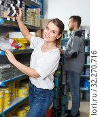Купить «Woman choosing household tools», фото № 32270716, снято 17 мая 2018 г. (c) Яков Филимонов / Фотобанк Лори