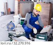 Купить «Worker is choosing tools in suitcase for work at the object.», фото № 32270916, снято 3 июня 2017 г. (c) Яков Филимонов / Фотобанк Лори