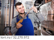 Купить «Worker man showing various tools at workplace», фото № 32270972, снято 15 марта 2017 г. (c) Яков Филимонов / Фотобанк Лори