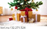 Купить «hands taking gift box from under christmas tree», видеоролик № 32271524, снято 6 декабря 2019 г. (c) Syda Productions / Фотобанк Лори