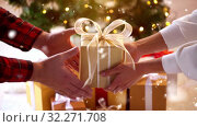 Купить «couple with gift box on christmas at home», видеоролик № 32271708, снято 13 ноября 2019 г. (c) Syda Productions / Фотобанк Лори
