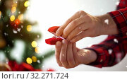 Купить «male hands with diamond ring in christmas gift box», видеоролик № 32271724, снято 8 декабря 2019 г. (c) Syda Productions / Фотобанк Лори