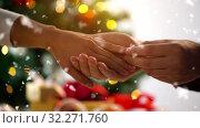 Купить «hands of couple with diamond ring on christmas», видеоролик № 32271760, снято 7 июля 2020 г. (c) Syda Productions / Фотобанк Лори