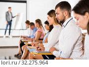 Купить «Side view of student group on lecture», фото № 32275964, снято 25 июля 2018 г. (c) Яков Филимонов / Фотобанк Лори