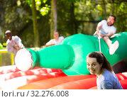 Купить «Funny attraction with a huge inflatable bottle in an amusement park», фото № 32276008, снято 29 мая 2019 г. (c) Яков Филимонов / Фотобанк Лори