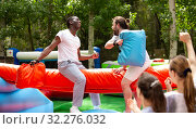 Купить «Men fighting by pillows on inflatable beam», фото № 32276032, снято 28 января 2020 г. (c) Яков Филимонов / Фотобанк Лори