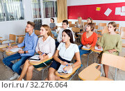 Купить «Portrait of modern young people listening to training session in auditorium», фото № 32276064, снято 26 сентября 2018 г. (c) Яков Филимонов / Фотобанк Лори
