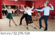Young people dancing lindy hop in pairs in modern dance hall. Стоковое фото, фотограф Яков Филимонов / Фотобанк Лори