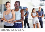 Купить «Young smiling people practicing passionate samba in dance class», фото № 32276172, снято 30 июля 2018 г. (c) Яков Филимонов / Фотобанк Лори