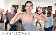 Купить «People dancing lindy hop during group training», фото № 32276208, снято 30 июля 2018 г. (c) Яков Филимонов / Фотобанк Лори
