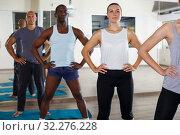 Group of active young people exercising hatha yoga workout. Стоковое фото, фотограф Яков Филимонов / Фотобанк Лори