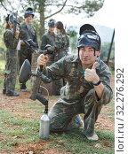 Купить «Paintball player in camouflage with gun», фото № 32276292, снято 22 сентября 2018 г. (c) Яков Филимонов / Фотобанк Лори