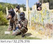 Купить «Portrait of team of adult people playing on paintball battlefield outdoor», фото № 32276316, снято 22 сентября 2018 г. (c) Яков Филимонов / Фотобанк Лори