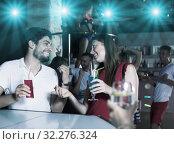 Купить «Couple talking in nightclub», фото № 32276324, снято 28 августа 2017 г. (c) Яков Филимонов / Фотобанк Лори