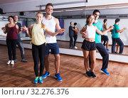 Купить «Dancing couples learning salsa», фото № 32276376, снято 19 ноября 2019 г. (c) Яков Филимонов / Фотобанк Лори