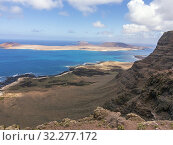 Купить «Funny Island fron the viewpoint of the Snows. Lanzarote. Canary Islands. Spain. Europe.», фото № 32277172, снято 24 апреля 2019 г. (c) age Fotostock / Фотобанк Лори