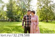 Купить «happy couple in summer park», фото № 32278588, снято 18 августа 2019 г. (c) Syda Productions / Фотобанк Лори