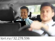 Купить «man with tablet pc and headphones riding in car», фото № 32278596, снято 25 августа 2019 г. (c) Syda Productions / Фотобанк Лори