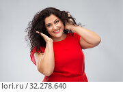 Купить «happy woman touching her hair over grey background», фото № 32278640, снято 15 сентября 2019 г. (c) Syda Productions / Фотобанк Лори