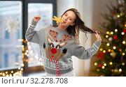 Купить «woman in christmas sweater with reindeer pattern», фото № 32278708, снято 9 декабря 2018 г. (c) Syda Productions / Фотобанк Лори
