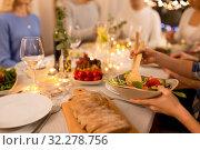 Купить «happy family having dinner party at home», фото № 32278756, снято 15 декабря 2018 г. (c) Syda Productions / Фотобанк Лори