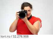 happy woman photographer with digital camera. Стоковое фото, фотограф Syda Productions / Фотобанк Лори