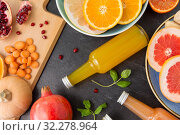 Купить «glass bottles of fruit and vegetable juices», фото № 32278964, снято 5 апреля 2018 г. (c) Syda Productions / Фотобанк Лори