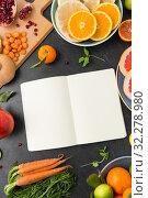 Купить «close up of notebook, fruits and vegetables», фото № 32278980, снято 5 апреля 2018 г. (c) Syda Productions / Фотобанк Лори