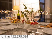 table served with plates, wine glasses and food. Стоковое фото, фотограф Syda Productions / Фотобанк Лори
