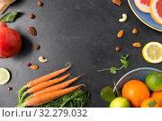 Купить «different vegetables and fruits on on slate table», фото № 32279032, снято 5 апреля 2018 г. (c) Syda Productions / Фотобанк Лори
