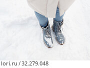 Купить «female feet in winter shoes on snow from top», фото № 32279048, снято 20 января 2019 г. (c) Syda Productions / Фотобанк Лори