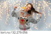 Купить «woman in christmas sweater with reindeer pattern», фото № 32279056, снято 9 декабря 2018 г. (c) Syda Productions / Фотобанк Лори