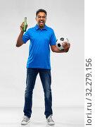 Купить «football fan with soccer ball celebrating victory», фото № 32279156, снято 8 сентября 2019 г. (c) Syda Productions / Фотобанк Лори