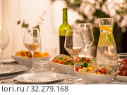Купить «table served with plates, wine glasses and food», фото № 32279168, снято 15 декабря 2018 г. (c) Syda Productions / Фотобанк Лори