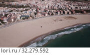 Купить «Aerial view of small Mediterranean coastal town of Torredembarra in Catalonia, Spain», видеоролик № 32279592, снято 18 марта 2019 г. (c) Яков Филимонов / Фотобанк Лори