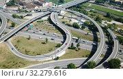 Купить «Aerial view of highway grade separation in Barcelona, Spain», видеоролик № 32279616, снято 12 июня 2018 г. (c) Яков Филимонов / Фотобанк Лори