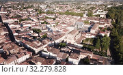 Купить «Aerial view of summer cityscape of small French town of Marmande overlooking Gothic building of Our Lady Church», видеоролик № 32279828, снято 18 июля 2019 г. (c) Яков Филимонов / Фотобанк Лори