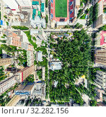 Купить «Aerial city view with crossroads and roads, houses, buildings, parks and parking lots. Sunny summer panoramic image», фото № 32282156, снято 21 января 2020 г. (c) Александр Маркин / Фотобанк Лори