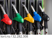 Купить «Заправочные пистолеты с бензином разного октанового числа и дизельным топливом для автомобилей», фото № 32282308, снято 9 мая 2019 г. (c) Литвяк Игорь / Фотобанк Лори