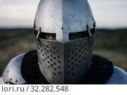 Купить «Medieval knight in armor and helmet closeup view», фото № 32282548, снято 5 июля 2019 г. (c) Tryapitsyn Sergiy / Фотобанк Лори