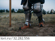 Купить «Medieval knight legs in metal armor, back view», фото № 32282556, снято 5 июля 2019 г. (c) Tryapitsyn Sergiy / Фотобанк Лори