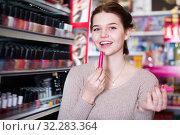Купить «Glad customer searching for reliable lipstick», фото № 32283364, снято 21 февраля 2017 г. (c) Яков Филимонов / Фотобанк Лори