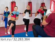 Купить «Group of smiling female are doing kick in gym», фото № 32283384, снято 8 октября 2017 г. (c) Яков Филимонов / Фотобанк Лори