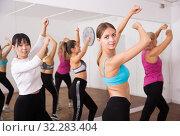 Купить «Ordinary active females exercising dance moves», фото № 32283404, снято 21 сентября 2019 г. (c) Яков Филимонов / Фотобанк Лори