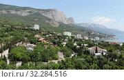 Купить «Foros. Crimea - June 9. 2019.View of the village from a height», видеоролик № 32284516, снято 16 октября 2019 г. (c) Володина Ольга / Фотобанк Лори