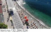 Купить «Yalta, Crimea -June 27. 2019 The Famous city paid Massandra beach», видеоролик № 32284524, снято 17 октября 2019 г. (c) Володина Ольга / Фотобанк Лори
